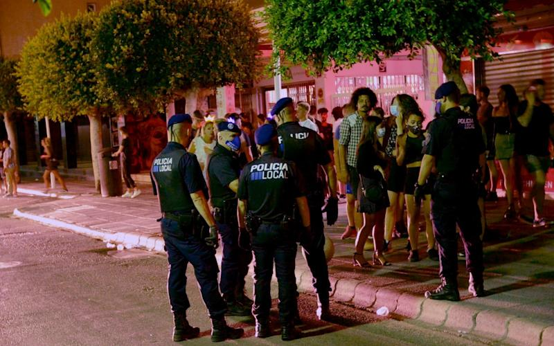 Police are called to the party strip Punta Ballena to deal with rowdy British drinkers as the tourists begin to return to Magaluf in Majorca - MTE/SOLARPIX.COM