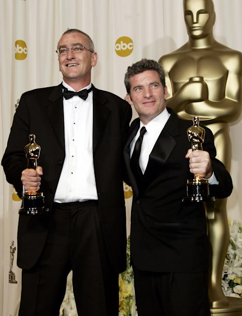 "FILE - In this March 5, 2006 file photo, Mike Hopkins, left, and Ethan Van der Ryn pose with the Oscar for achievement in sound editing for their work on ""King Kong"" at the 78th Academy Awards in Los Angeles. Oscar-winning sound editor Mike Hopkins, who worked on the ""Lord of the Rings"" trilogy and other blockbusters, has died in a rafting accident in New Zealand. Police Senior Sergeant Carolyn Watson said the 53-year-old Hopkins drowned on Sunday, Dec. 30, 2012 after his raft capsized in a river on New Zealand's North Island. (AP Photo/Kevork Djansezian, File)"