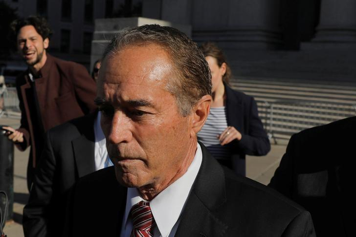 FILE PHOTO: Chris Collins, former U.S. Representative for New York's 27th congressional district departs after pleading guilty at Federal Court in New York City, New York