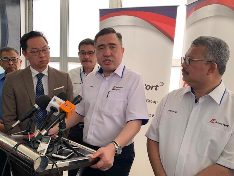 Transport Minister Anthony Loke said the government was clear in enforcing the law and warned lorry operators that they will still face fines for overloading. — Picture by Ben Tan