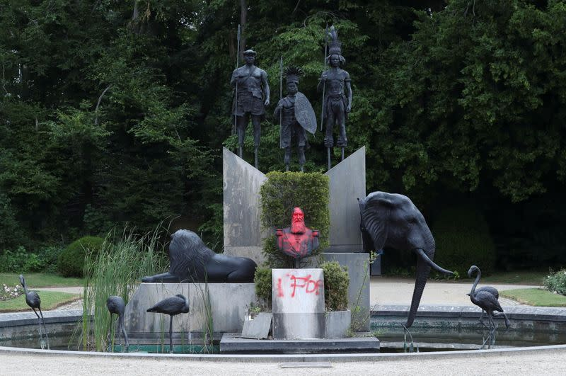 A statue of former Belgian King Leopold II sprayed with a graffiti is seen in the park of the Africa Museum, in Tervuren