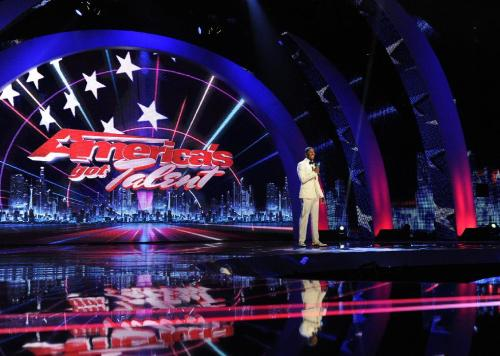 "This Sept. 14, 2012 photo released by NBC shows host Nick Cannon on stage during auditions for the talent competition series ""America's Got Talent,"" in Newark, N.J. The new season of ""America's Got Talent"" starts Tuesday at 9 p.m. EDT. New judges include former Spice Girl Mel B. and supermodel/personality Heidi Klum joining forces with Howie Mandel and Howard Stern. (AP Photo/NBC, Virginia Sherwood)"