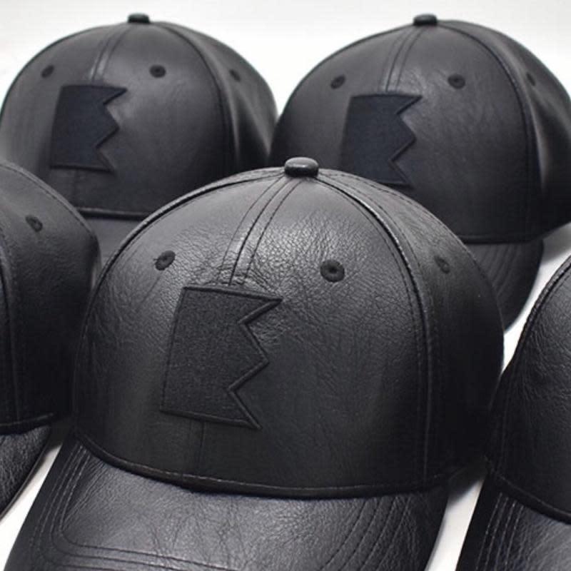 EMMYDEVEAUX Faux Leather Hat. (Image via EMMYDEVEAUX)
