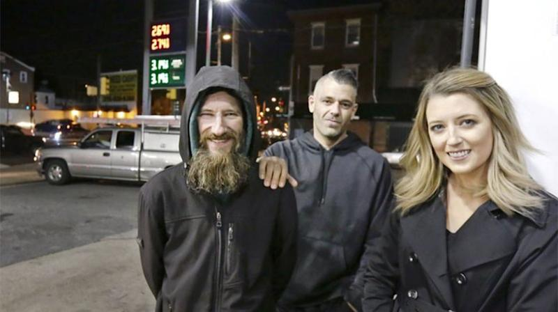 Johnny Bobbitt Jr, left, Kate McClure, right, and McClure's boyfriend Mark D'Amico pose at a Citgo station in Philadelphia. Source: AP
