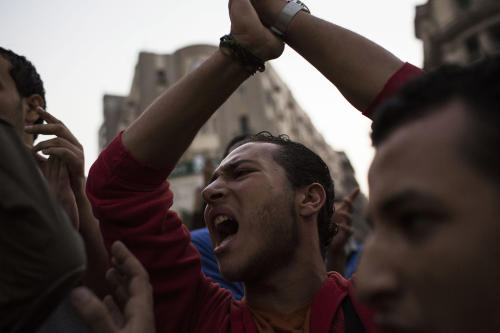 Egyptian youths chant slogans during a demonstration in support of Egyptian political satirist Bassem Youssef after a local TV station stops the airing of his show in Cairo, Egypt, Saturday Nov. 2, 2013. A prominent Egyptian statesman criticized Saturday a local TV station for stopping the airing of a widely popular satire show by Youssef, describing the decision as unwise and harmful to the country. (AP Photo/Manu Brabo)