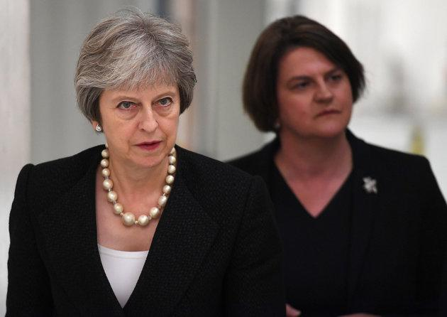 Prime Minister Theresa May (left) and Arlene Foster, the leader of the Democratic Unionist Party (DUP).