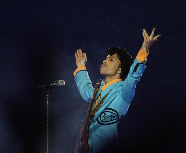 "FILE- In this Feb. 4, 2007, file photo, Prince performs during the halftime show at Super Bowl XLI at Dolphin Stadium in Miami. On Friday, June 19, 2020, his ""Blue Angel"" Cloud 2 custom made electric guitar shot past the top estimate of $200,000 it was expected to fetch at the Music Icons sale at Julien's Auctions in Culver City, Calif. (AP Photo/Alex Brandon, File)"