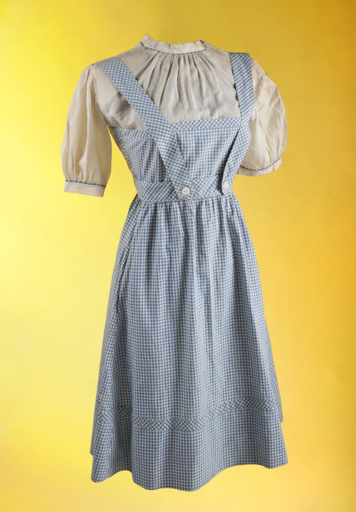 """This undated publicity photo provided by Julien's Auctions shows the original costume worn by Judy Garland in the film """"The Wizard of Oz."""" The dress will be on view at London's Safford Hotel Oct. 9-14, 2012, before being exhibited on Nov. 5 through 9, in Beverly Hills, Calif. (AP Photo/Julien's Auctions)"""