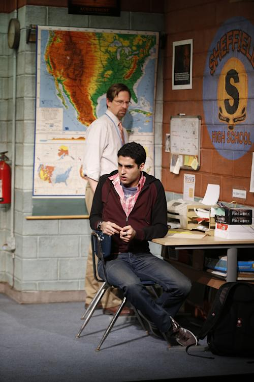 """This theater image released by Sam Rudy Media Relations shows Stephen Barker Turner as Dr. Danielson, and Babak Tafti as Khadim Asmaan, foreground, from The Vineyard Theatre's production, """"The North Pool."""" (AP Photo/Sam Rudy Media Relations, Carol Rosegg)"""