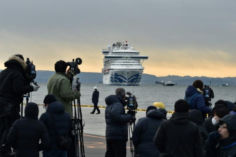 The media keep watch on the Diamond Princess cruise ship with over 3,000 people on board as it sits in quarantine at Yokohama port