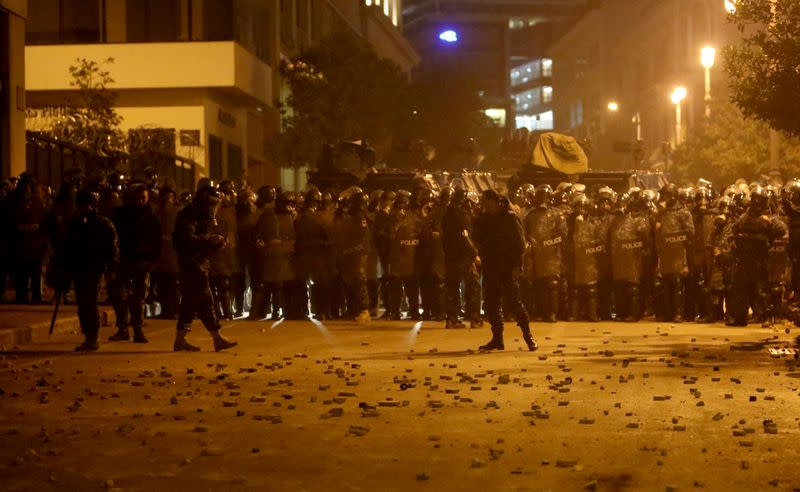 FILE PHOTO: Stones are seen on the ground as Lebanese police gather during a protest against the newly formed government in Beirut