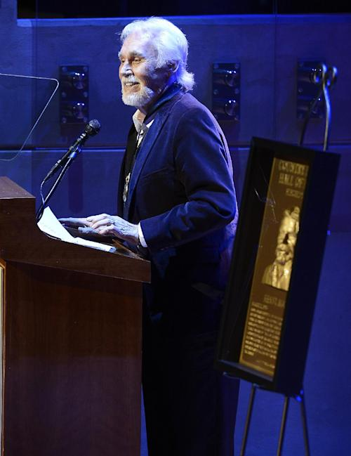 "Country music star Kenny Rogers gives his acceptance speech at the ceremony for the 2013 inductions into the Country Music Hall of Fame on Sunday, Oct. 27, 2013, in Nashville, Tenn. The inductees are Bobby Bare, the late ""Cowboy"" Jack Clement and Kenny Rogers. (AP Photo/Mark Zaleski)"
