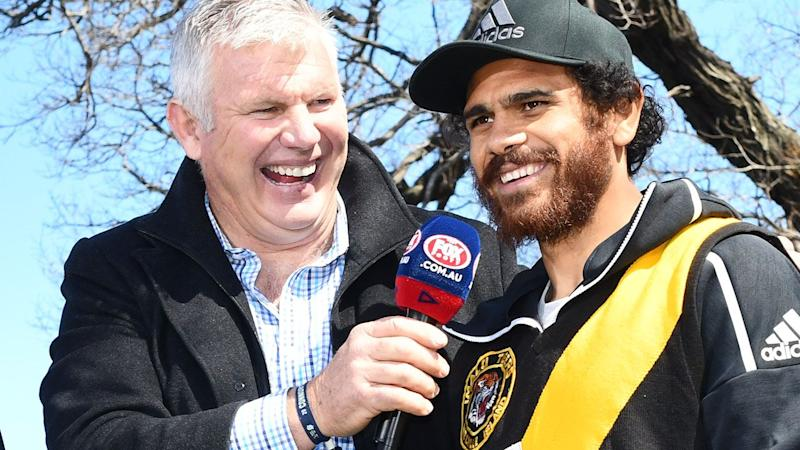 Danny Frawley, pictured here with Cyril Rioli before the AFL grand final in 2018.
