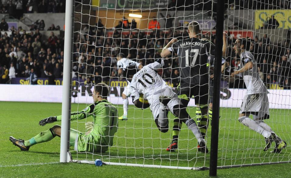 Swansea City's Wilfried Bony retrieves the ball after scoring against Stoke City during English Premier League in Swansea, Wales
