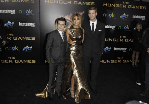 "From left, Josh Hutcherson, Jennifer Lawrence and Liam Hemsworth arrive at the world premiere of ""The Hunger Games"" on Monday March 12, 2012 in Los Angeles. (AP Photo/Matt Sayles)"