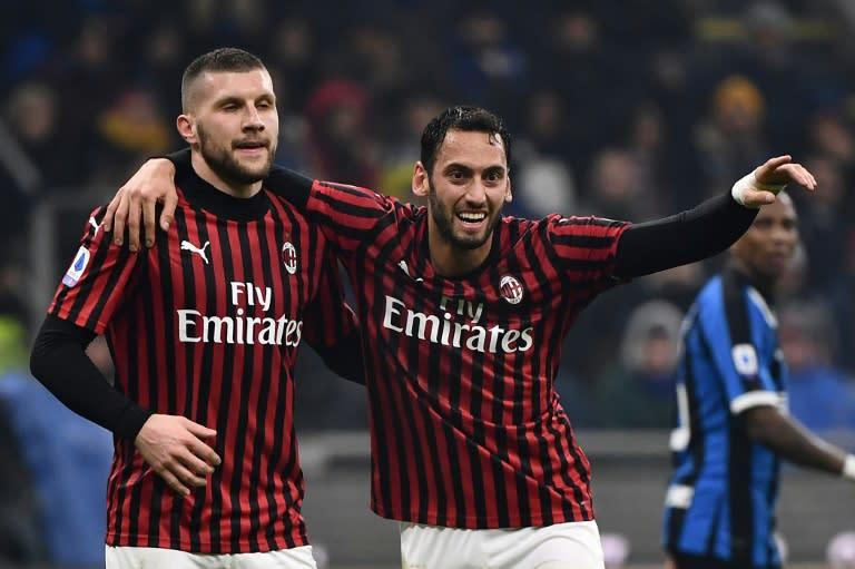 Ante Rebic and midfielder Hakan Calhanoglu downed Roma on Sunday