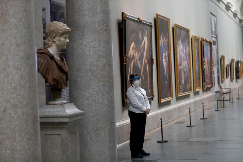 FILE PHOTO: A museum worker wears a protective mask as the Prado museum prepares for reopening on June 6th amid the coronavirus disease (COVID-19) outbreak, in Madrid