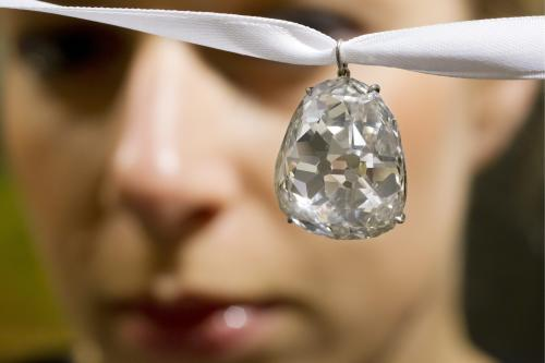 FILE - In this May 2, 2012 file photo an employee shows the Beau Sancy diamond, 34.98 carat, at Sotheby's auction house in Zurich, Switzerland. Marie de Medici wore it at her coronation as Queen Consort of Henry IV in 1610, and now the Beau Sancy diamond is a lavish accessory owned by an anonymous bidder who paid US $9.7 million (7.6 million euro) for it at Sotheby's auction in Geneva Tuesday May 15, 2012. The spring auction season for jewelry and watches is upon Geneva, where elegant lakefront hotels fill with well-heeled buyers and bidders in a scene far removed from the debate over European austerity. (AP Photo / Keystone, Alessandro Della Bella, File)