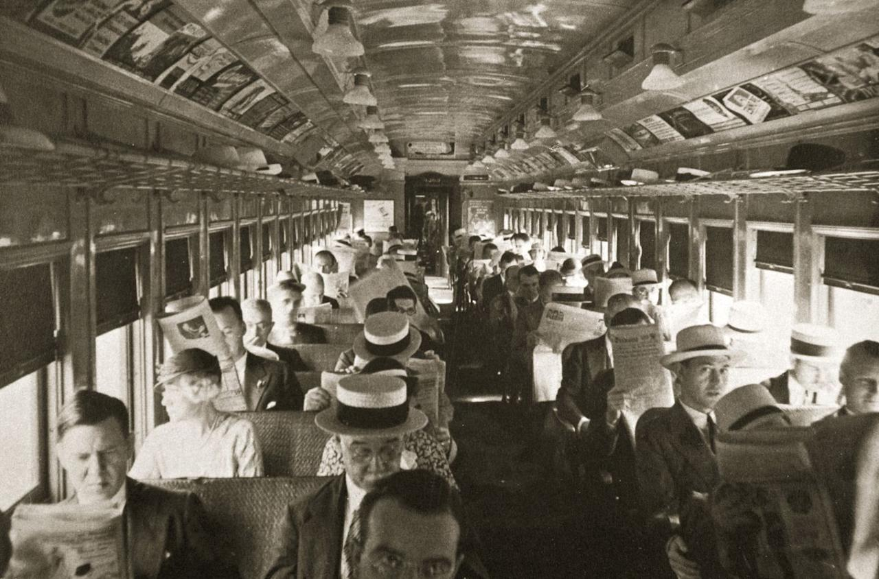 <p>A railcar makes the morning commute in New York City, as passengers read newspapers and gaze out the window.</p>