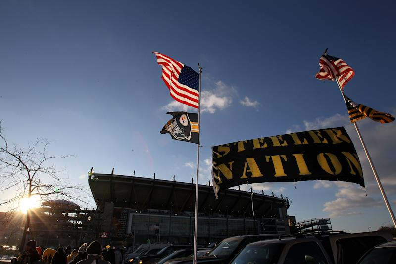 """PITTSBURGH, PA - JANUARY 23: """"Steeler Nation"""" tailgates outside the stadium prior to the Pittsburgh Steelers and the New York Jets playing in the 2011 AFC Championship game at Heinz Field on January 23, 2011 in Pittsburgh, Pennsylvania. (Photo by Ronald Martinez/Getty Images)"""
