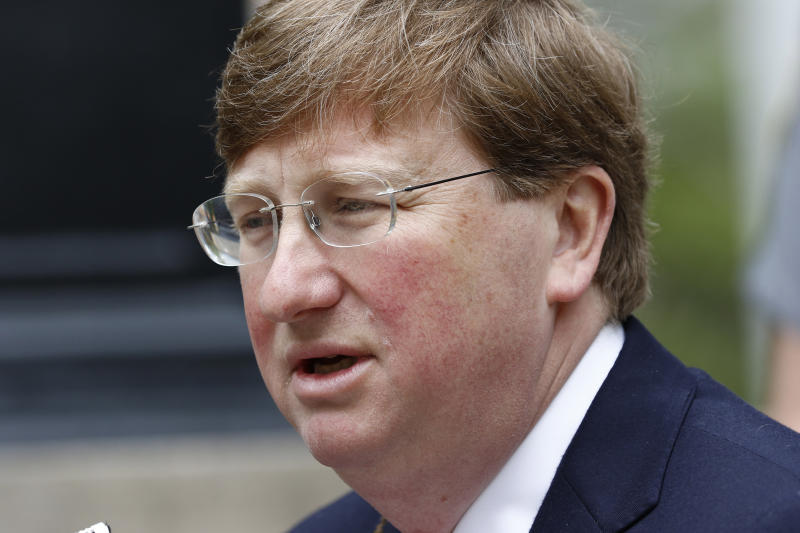 FILE - In this Tuesday, March 24, 2020, file photo, Mississippi Republican Gov. Tate Reeves speaks with reporters outside the Governor's Mansion to give an update on the current situation of the new coronavirus in the state and discuss Mississippi's ongoing response to slow the spread, in Jackson, Miss. In Mississippi, home to nearly 3 million people, Reeves has allowed most businesses to stay open, even restaurants, so long as they serve no more than 10 people at a time, amid the new coronavirus pandemic. (AP Photo/Rogelio V. Solis, File)