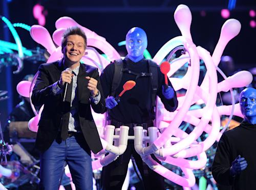 Michel Telo, left, and Blue Man Group perform at the 13th Annual Latin Grammy Awards at Mandalay Bay on Thursday, Nov. 15, 2012, in Las Vegas. (Photo by Al Powers/Powers Imagery/Invision/AP)