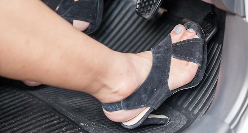 Victoria Police sparked online debate over the right shoes to wear while driving. A stock image of a person wearing high heels while driving.