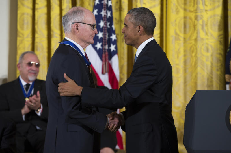 In this Nov. 24, 2015, file photo, President Barack Obama, right, shakes hands with former head of the EPA and director of the FBI William Doyle Ruckelshaus, after presenting him with the Presidential Medal of Freedom during a ceremony in the East Room of the White House in Washington. Ruckelshaus, who famously quit his job in the Justice Department rather than carry out President Richard Nixon's order to fire the special prosecutor investigating the Watergate scandal, has died. He was 87. The EPA confirmed his death in a statement Wednesday, Nov. 27, 2019. (AP Photo/Evan Vucci)