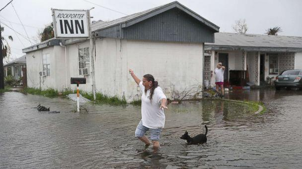 PHOTO: Valerie Brown walks through a flooded area after leaving the apartment that she road out Hurricane Harvey in, Aug. 26, 2017, in Rockport, Texas. (Joe Raedle/Getty Images)