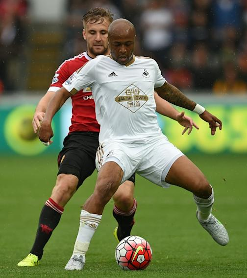 Swansea City's Andre Ayew (R) and Manchester United's Luke Shaw during their Premier League match at The Liberty Stadium in Swansea on August 30, 2015