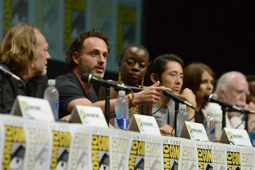 """The cast and crew of """"The Walking Dead """" participates in a panel on Day 3 of Comic-Con International on Friday, July 19, 2103, in San Diego. (Photo by Jordan Strauss/Invision/AP)"""