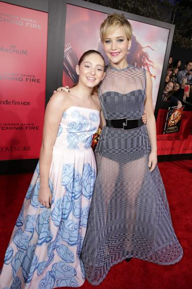 Willow Shields, left, and Jennifer Lawrence seen at Lionsgate's 'The Hunger Games: Catching Fire' Los Angeles Premiere, on Monday, Nov, 18, 2013 in Los Angeles. (Photo by Eric Charbonneau/Invision for Lionsgate/AP Images)
