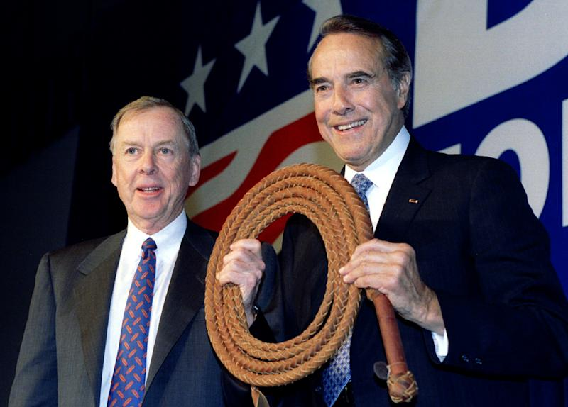U.S. Senator Bob Dole (R) is presented a bullwhip April 12 by T. Boone Pickins (L), at a fund raising stop in Dallas two days into Dole's campaign for the U.S. presidency. Pickens said the whip was to help Dole get things done in Washington D.C - Reuters Images