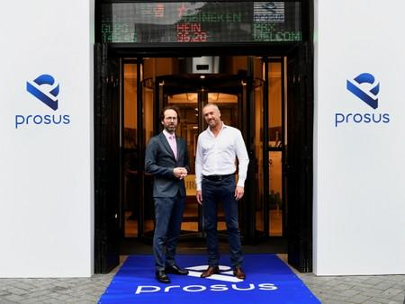 Maurice van Tilburg, CEO of Euronext Amsterdam and Bob van Dijk, CEO of Naspers and Prosus Group pose at Amsterdam's stock exchange building as Prosus begins trading on the Euronext stock exchange in Amsterdam