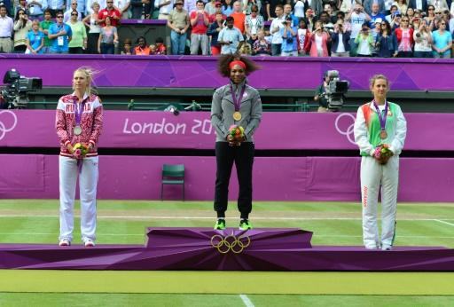 Striking gold: Williams thrashed Sharapova to claim the 2012 Olympics title. Victoria Azarenka took bronze