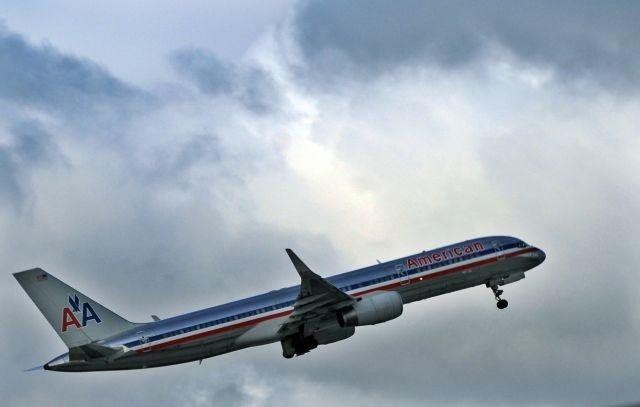 American Airlines resumes trying to pack planes as virus cases surge