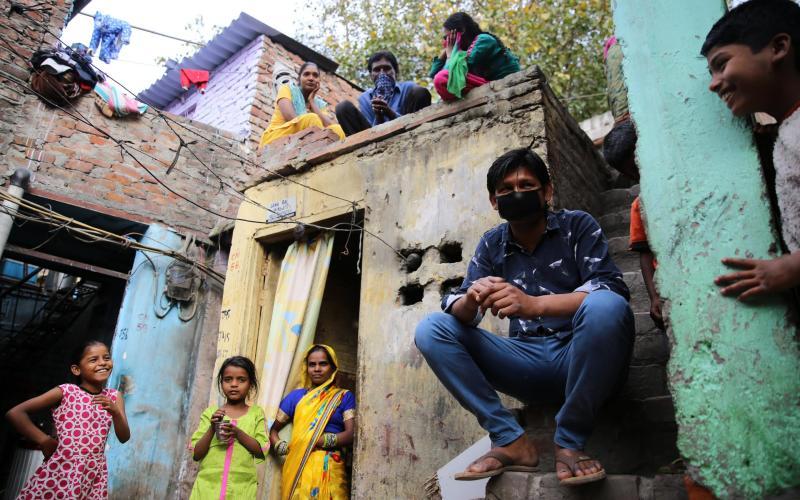 Up to twelve people share can one room in the Sarai Kale Khan slum in New Delhi - Cheena Kapoor