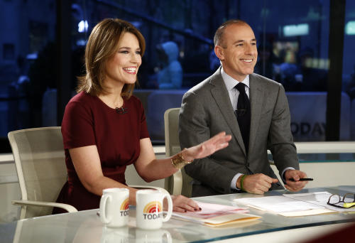 "This Feb. 8, 2013 photo released by NBC shows co-hosts Savannah Guthrie, left, and Matt Lauer during a broadcast of the ""Today"" show in New York. A top NBC executive says the network is not considering replacing Matt Lauer as anchor of the ""Today"" show. NBC News executive Alex Wallace, who oversees the troubled morning show, made the comment Wednesday, March 27, 2013, in response to reports that the network had approached CNN's Anderson Cooper about the ""Today"" job. (AP Photo/NBC, Peter Kramer)"