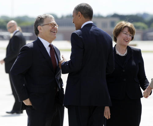 FILE - In this June 1, 2012 file photo, President Barack Obama is greeted by Sen. Al Franken, D-Minn., left, and Sen. Amy Klobuchar, D-Minn. upon his arrival at Minneapolis-St. Paul International Airport in Minneapolis. Republicans figured he would be an easy target the second time around. But Franken has transformed his race into one that many national Republicans are writing off, choosing to focus their money instead on more vulnerable Democrats. He's done it in part by transforming his image from the wisecracking former Saturday Night Live star into quiet policy work. (AP Photo/Carolyn Kaster)