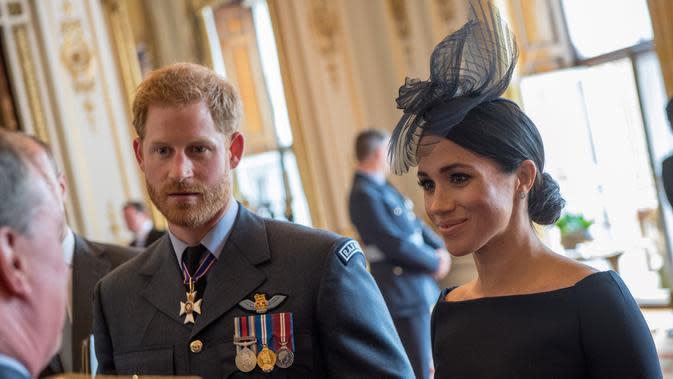 Pangeran Harry dan Meghan Markle putuskan tinggalkan Kerajaan Inggris. (CHRIS J RATCLIFFE / POOL / AFP)