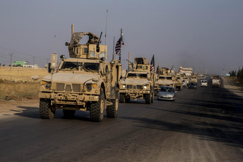 U.S. military convoy drives near the town of Qamishli, north Syria, Saturday, Oct. 26. 2019. A U.S. convoy of over a dozen vehicles was spotted driving south of the northeastern city of Qamishli, likely heading to the oil-rich Deir el-Zour area where there are oil fields, or possibly to another base nearby. The Syrian Observatory for Human Rights, a war monitor, also reported the convoy, saying it arrived earlier from Iraq. (AP Photo/Baderkhan Ahmad)