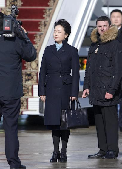 Chinese President Xi Jinping's wife Peng Liyuan listens to the national anthems after arriving at the government airport Vnukovo II, outside Moscow, Russia, on Friday, March 22, 2013. Russia is Xi Jinping's first foreign destination as China's president. Xi's talks with Putin on Friday are set to focus on oil and gas as China seeks to secure new energy resources to fuel its growing economy. (AP Photo/Ivan Sekretarev)
