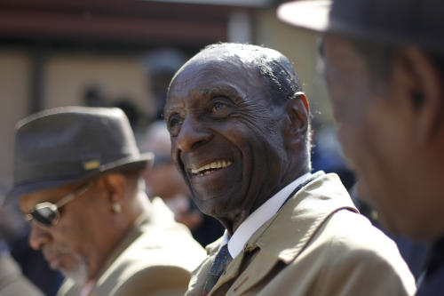 Musician Charlie Rice smiles during a ceremony outside of the former home of jazz musician John Coltrane Friday, April 13, 2012, in Philadelphia. Jazz lovers and cultural officials in Philadelphia are promoting a fundraising effort to save the run-down house. Coltrane lived in a rowhouse in the city's Strawberry Mansion neighborhood from 1952 to 1958. (AP Photo/Matt Rourke)