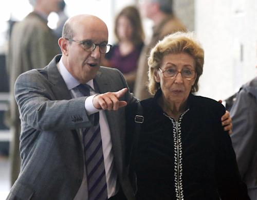 Attorney Shelly B. Kulwin escorts his client Jacqueline Goldberg through the federal court lobby after a federal jury returned with a finding in Donald Trump's favor in her civil case alleging that the real estate mogul cheated her in a skyscraper condo deal, Thursday, May 23, 2013 in Chicago. (AP Photo/Charles Rex Arbogast)