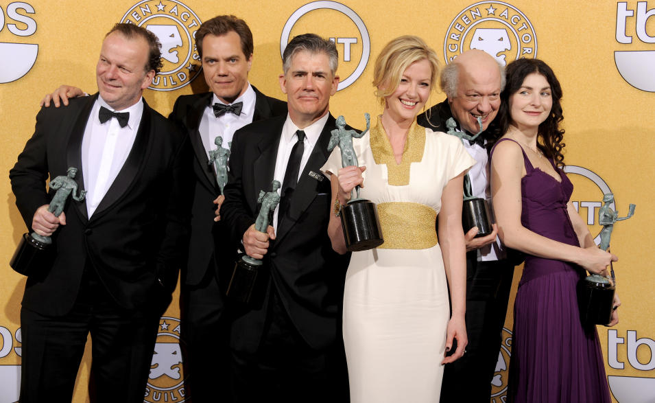 "From left, Robert Clohessy, Michael Shannon, Kevin O'Rourke, Gretchen Mol, Peter Van Wagner and Aleksa Palladino pose backstage with their awards for outstanding performance by an ensemble in a drama series for ""Boardwalk Empire"" at the 18th Annual Screen Actors Guild Awards on Sunday Jan. 29, 2012 in Los Angeles. (AP Photo/Chris Pizzello)"
