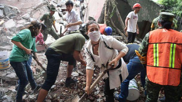 PHOTO: Rescuers, firefighters, policemen, soldiers and volunteers remove rubble and debris from a flattened building in search of survivors after a powerful quake in Mexico City on Sept. 19, 2017. (Ronaldo Schemidt/AFP/Getty Images)