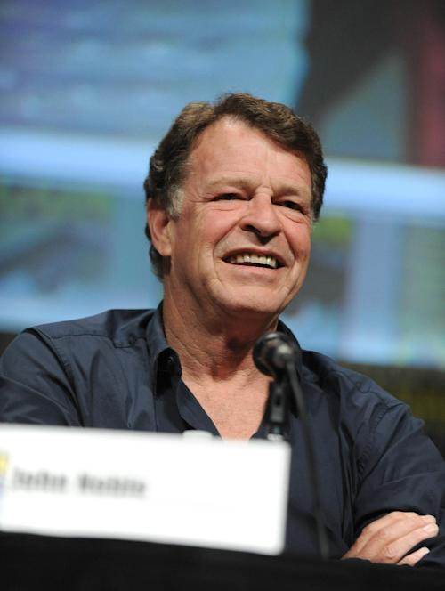 "John Noble speaks at the ""Fringe"" screening and panel at Comic-Con on Sunday, July 15, 2012 in San Diego. (Photo by Jordan Strauss/Invision/AP)"