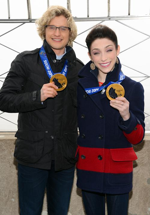 FILE - This Feb. 27, 2014 file photo shows Olympic gold medalist ice dancers Meryl Davis and Charlie White, left, at the Empire State Building in New York. They'll compete against, instead of with, each other. ABC said Tuesday that game show host Drew Carey, actor Billy Dee Williams and long distance swimmer Diana Nyad will also be in the show, which begins a new season on March 17. (Photo by Evan Agostini/Invision/AP, File)