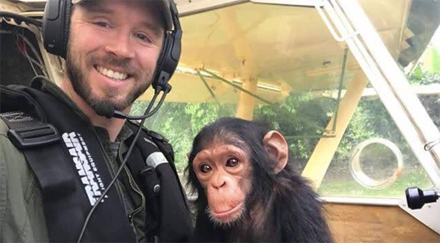 Virunga National Park pilot Anthony Caere with baby chimp Mussa. Source: Lwiro Primates/ Facebook