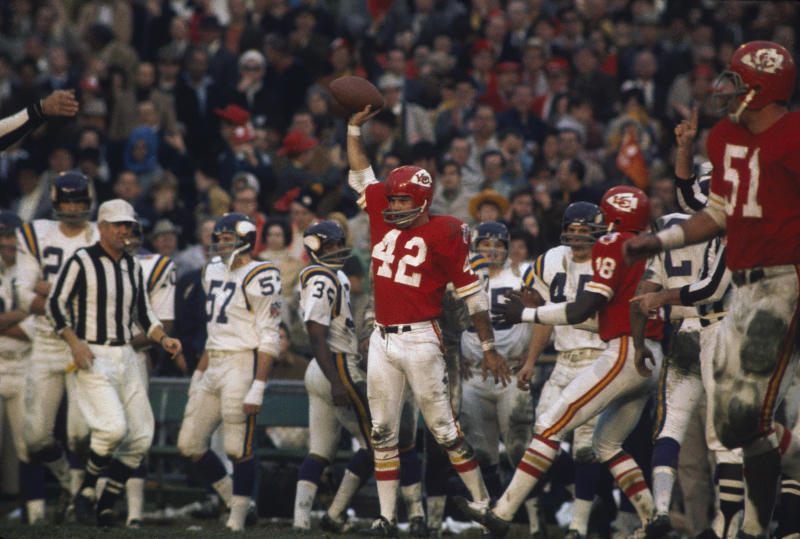 Safety Johnny Robinson celebrates with the ball during Super Bowl IV. (Getty Images)